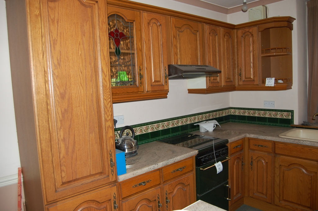 L shaped kitchen comprising oak fronted units sink for Long kitchen wall units