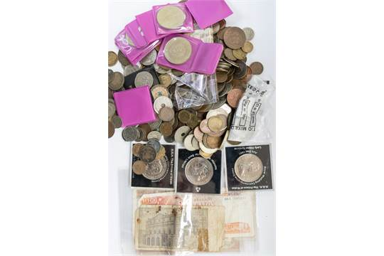 A bag of coins with a silver music medal and World War One