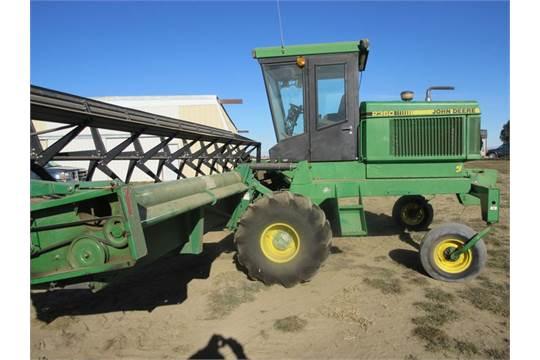 1992 John Deere 2360 grain swather, cab air heat, diesel