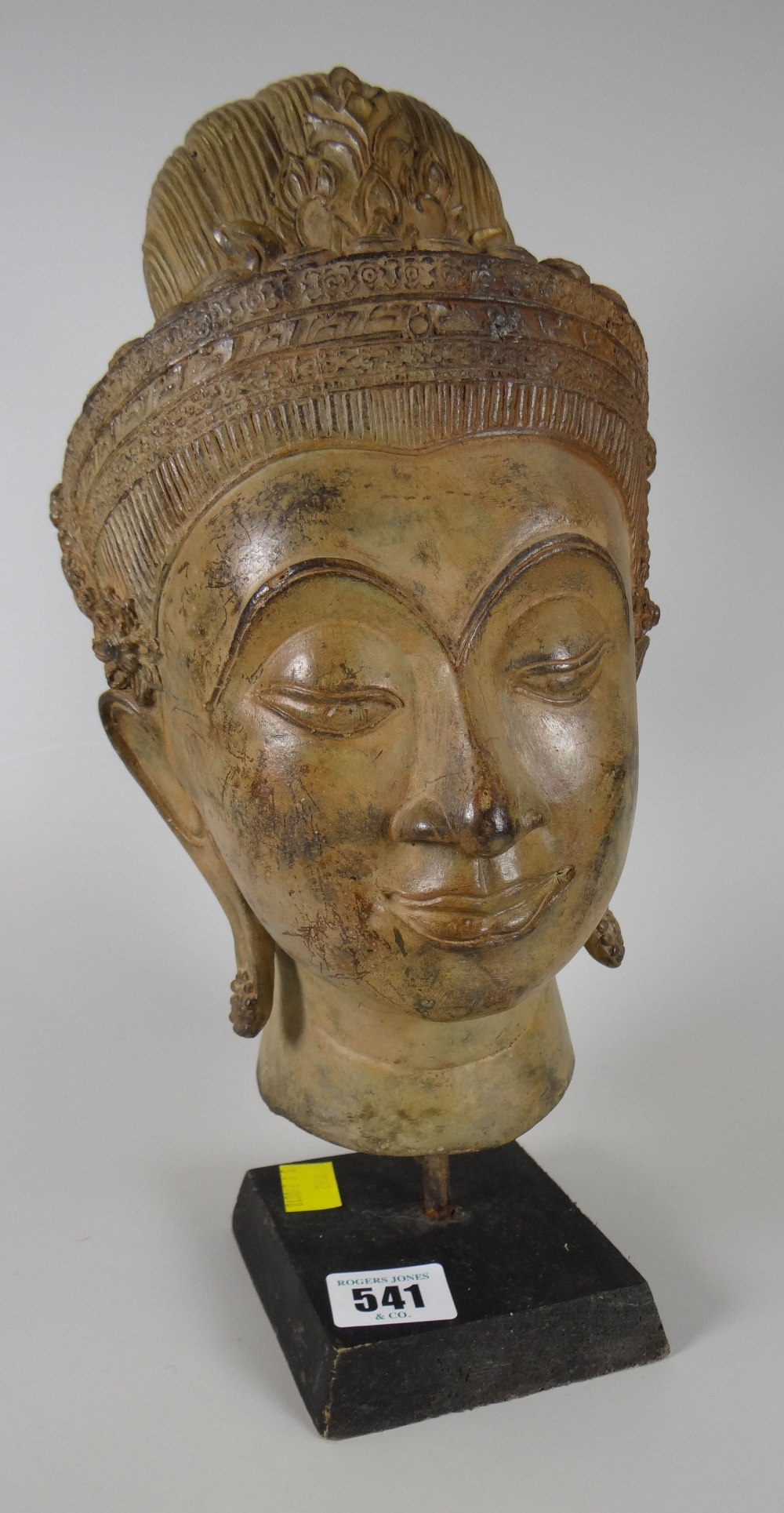 Lot 541 - A Cambodian khmer-style head