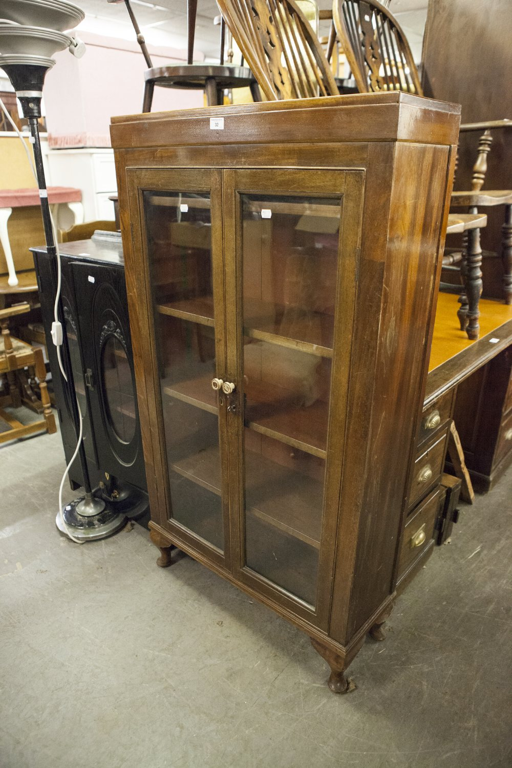 """Lot 32 - EARLY TWENTIETH CENTURY MAHOGANY TWO DOOR DISPLAY CABINET, with cabriole supports, 54 ½"""" high"""