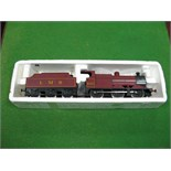 """A Lima """"0"""" Gauge Class 4F 0-6-0 Locomotive And Tender, R/No 4683, L.M.S maroon."""