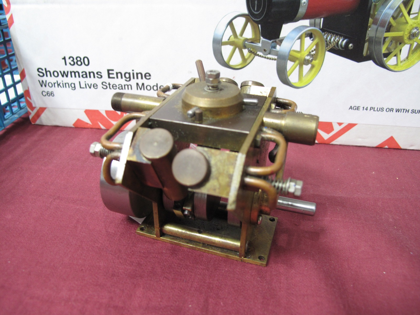 Lot 24 - A Small V4 Cylinder Engine, flywheel 4cm diameter, well built.