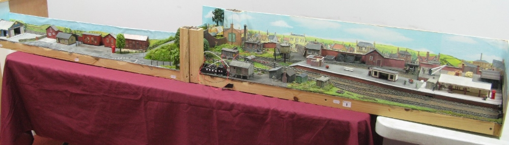 "Lot 1 - A ""00"" Scale Fold Out Exhibition Diorama, featuring station, garage, timber yard, signal bx, water"