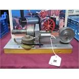A Single Cylinder Machined Horizontal Hot Air Engine, flywheel 5cm Diameter, base 23cm x 9cm.