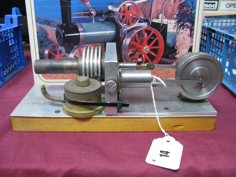 Lot 14 - A Single Cylinder Machined Horizontal Hot Air Engine, flywheel 5cm Diameter, base 23cm x 9cm.