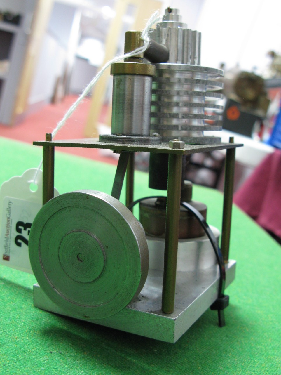 Lot 23 - A Small Single Cylinder Vertical Machined Hot Air Engine, Flywheel 4cm diameter, 12cm high.