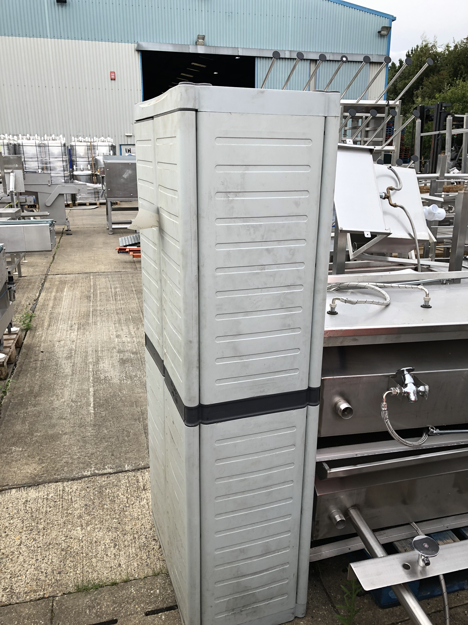 Two Plastic Cupboards, approx. 0.7m x 0.5m x 1.8m high, lift out charge - £20