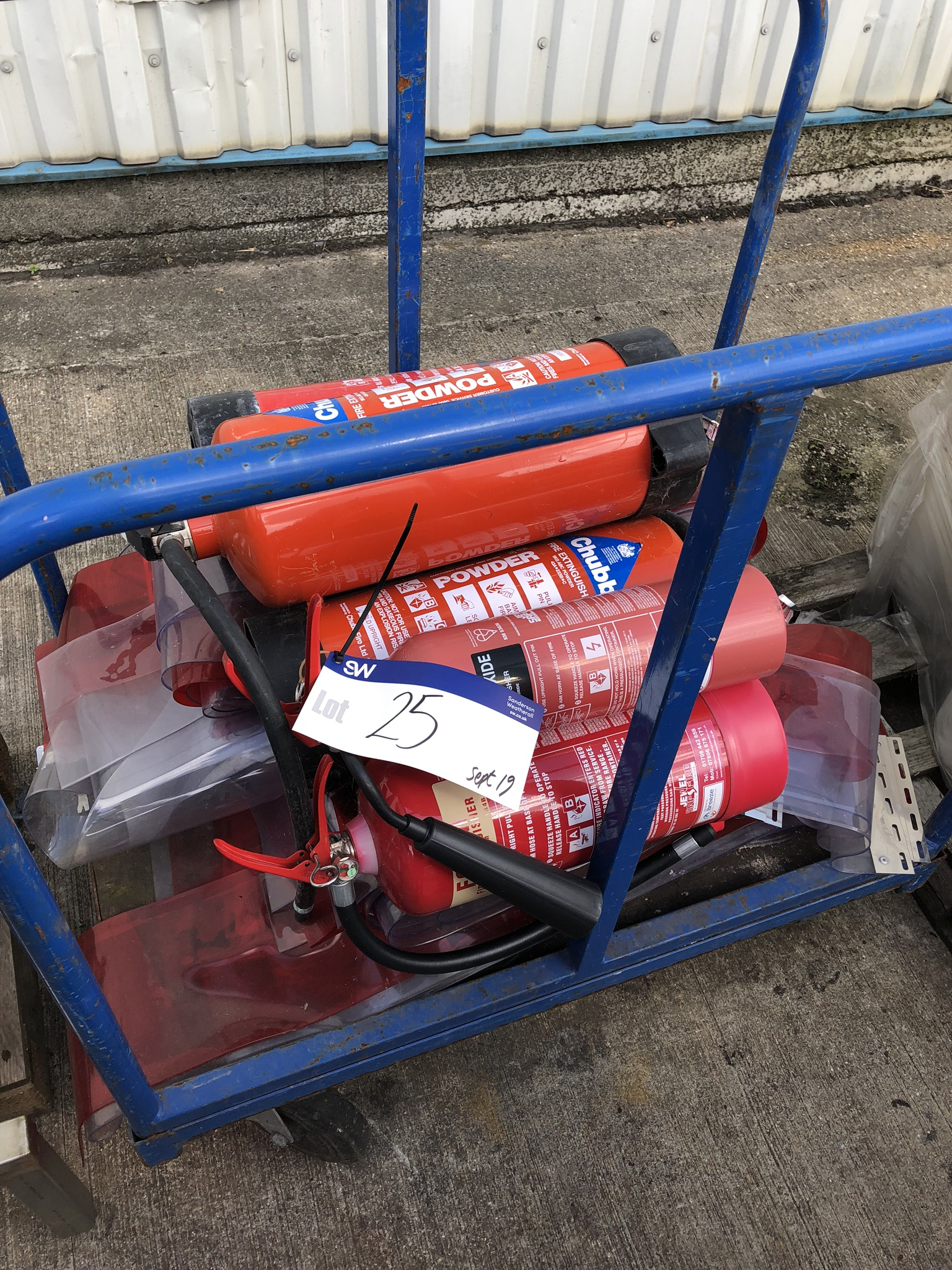 Trolley, with five fire extinguishers and plastic curtain, lift out charge - £20
