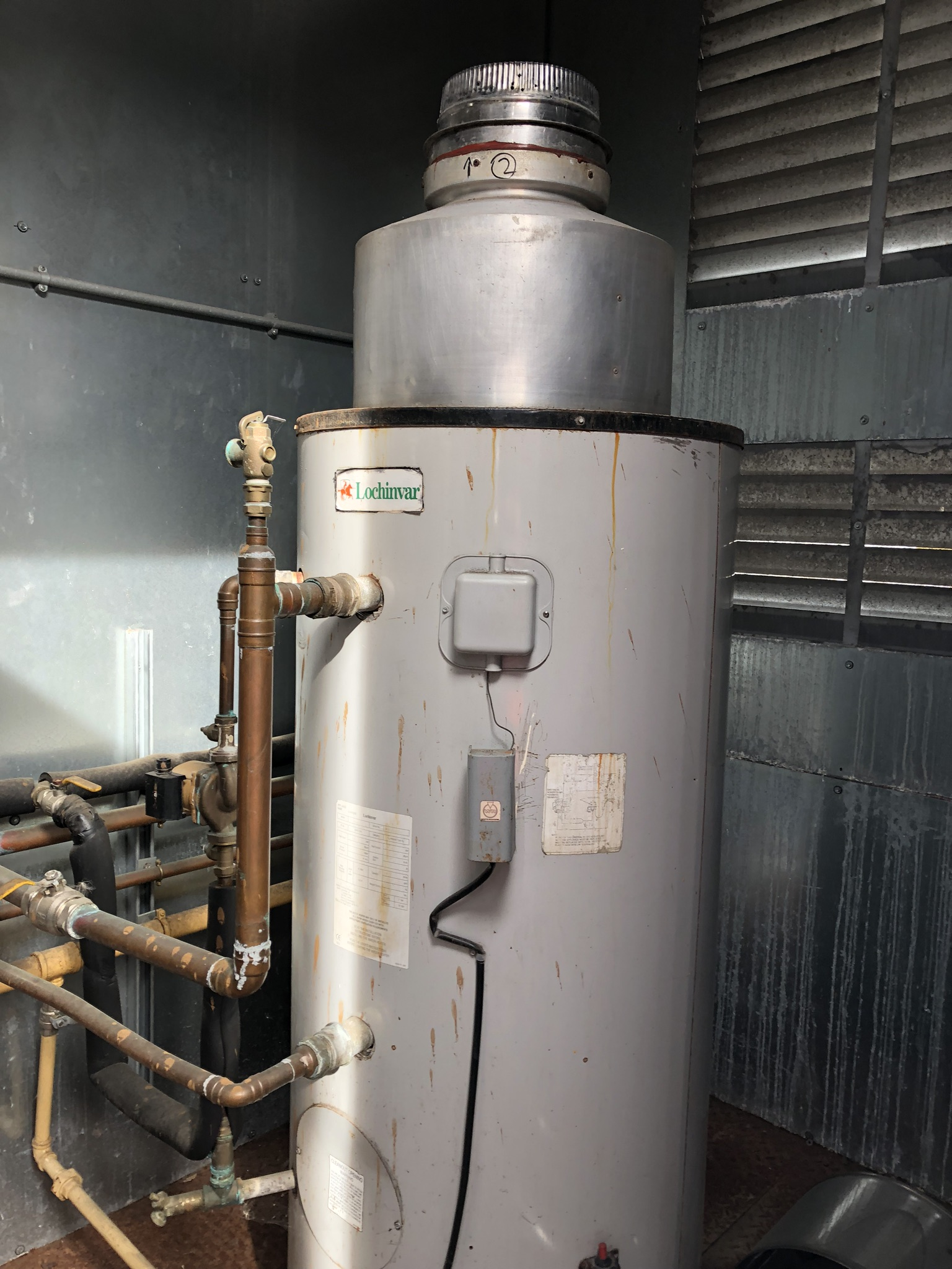 Two Lochnivar Gas Water Heaters, in container, with chimneys, lift out charge - £100 - Image 2 of 7