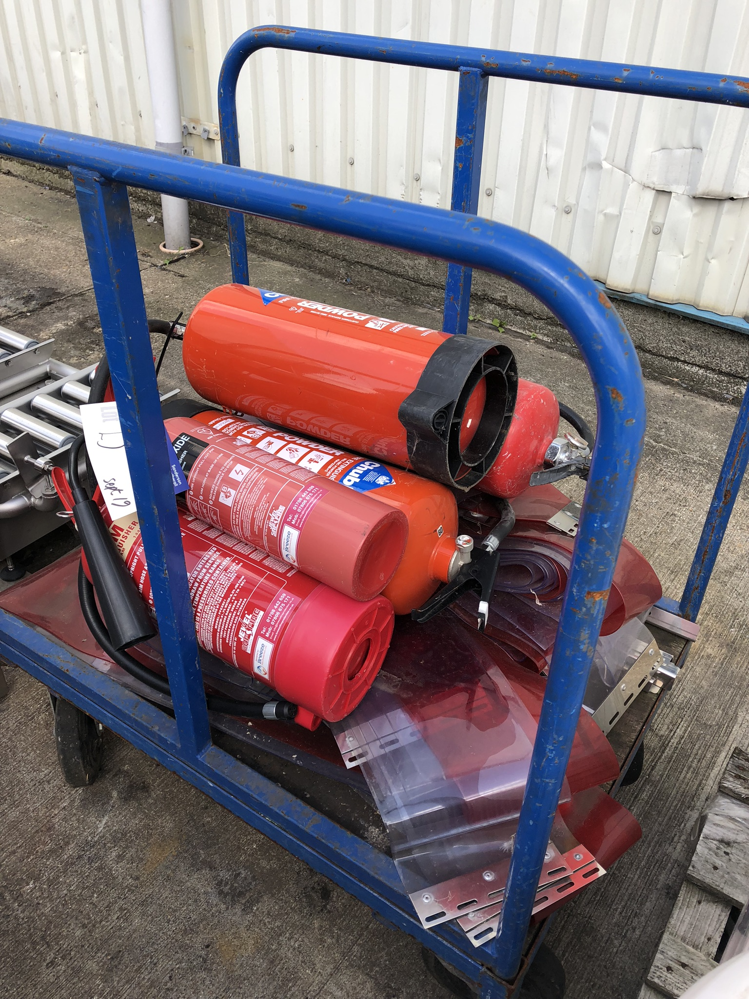 Trolley, with five fire extinguishers and plastic curtain, lift out charge - £20 - Image 2 of 2