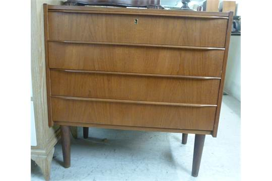 A 1970s Stewart Griffiths Furniture Teak Finished Chest, Having Four Equal,  Long Drawers With Bar