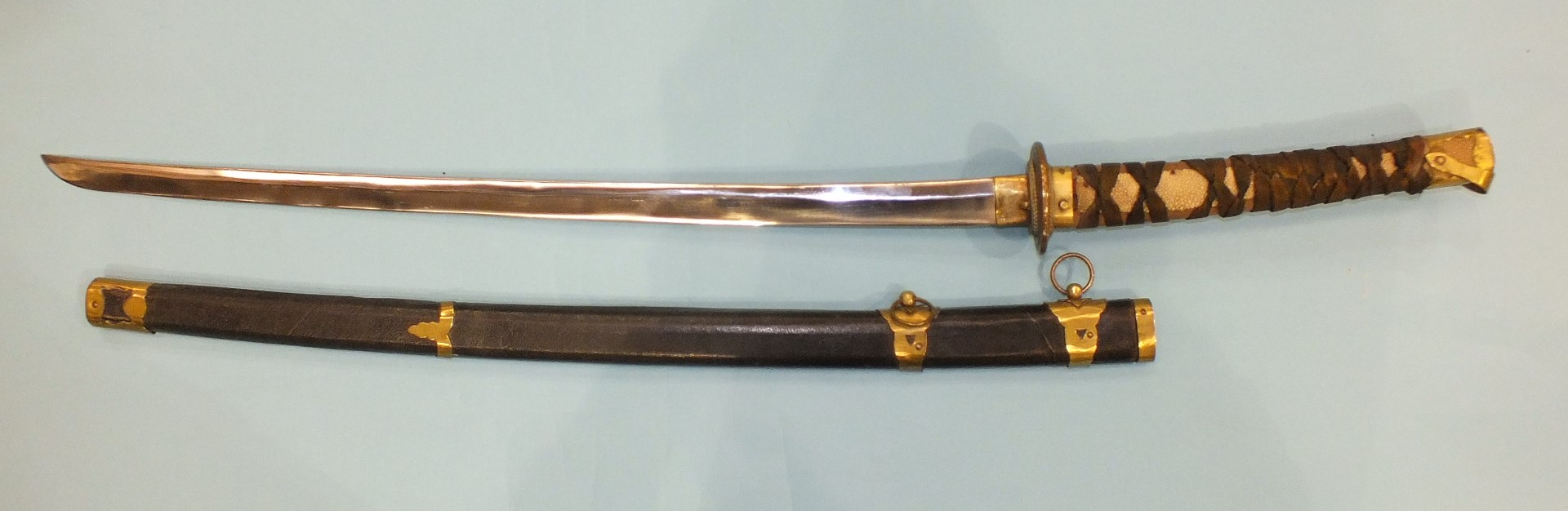 Lot 224 - A Japanese sword, with stainless steel blade (26cm) and partially-covered fish-skin-bound grip, with