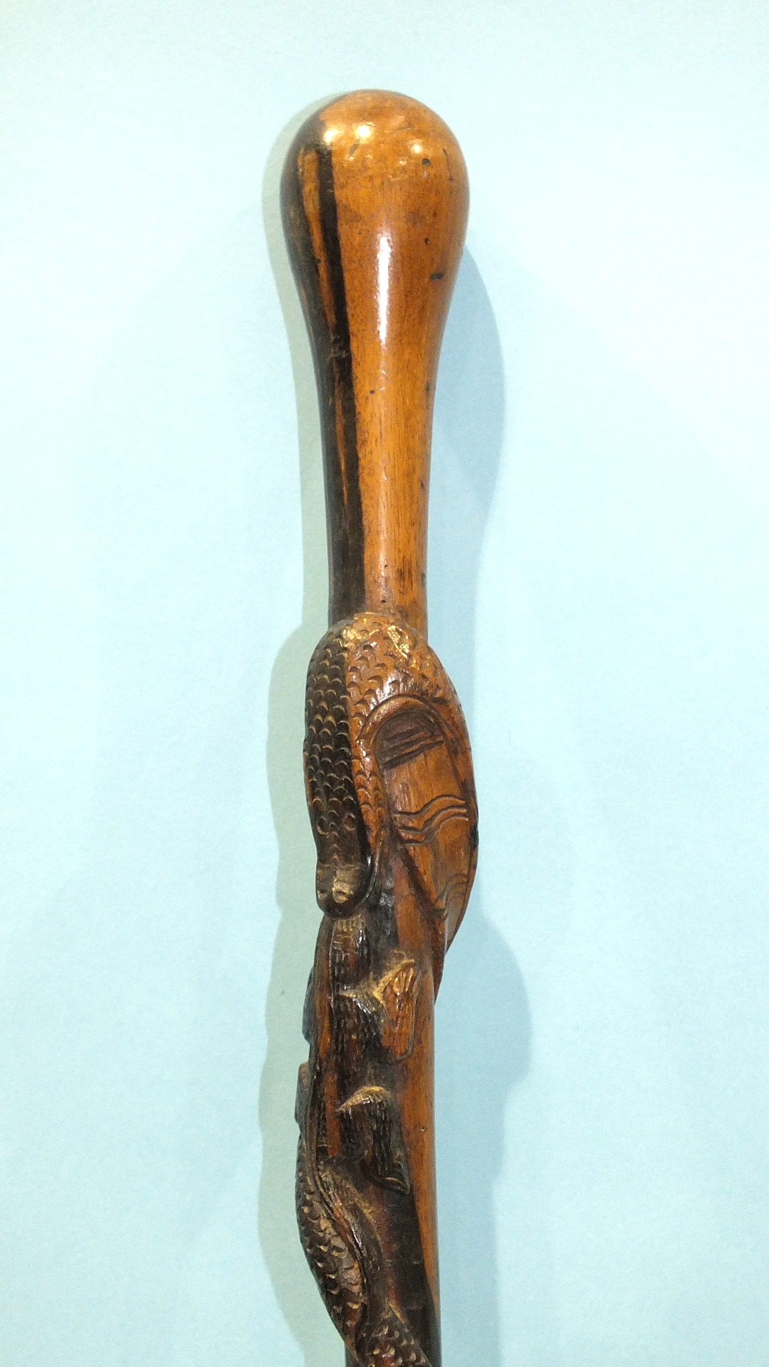 Lot 240 - An African hardwood walking stick carved with a snake and a salamander, 93cm long.