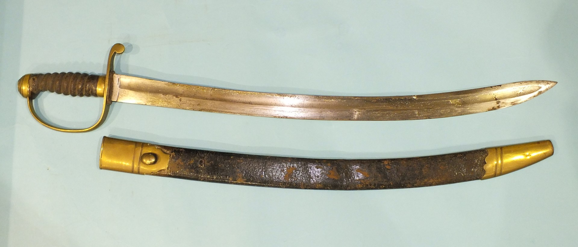 Lot 222 - A brass stirrup hilted short sabre with fish-skin grip and 61cm slightly curved blade in brass