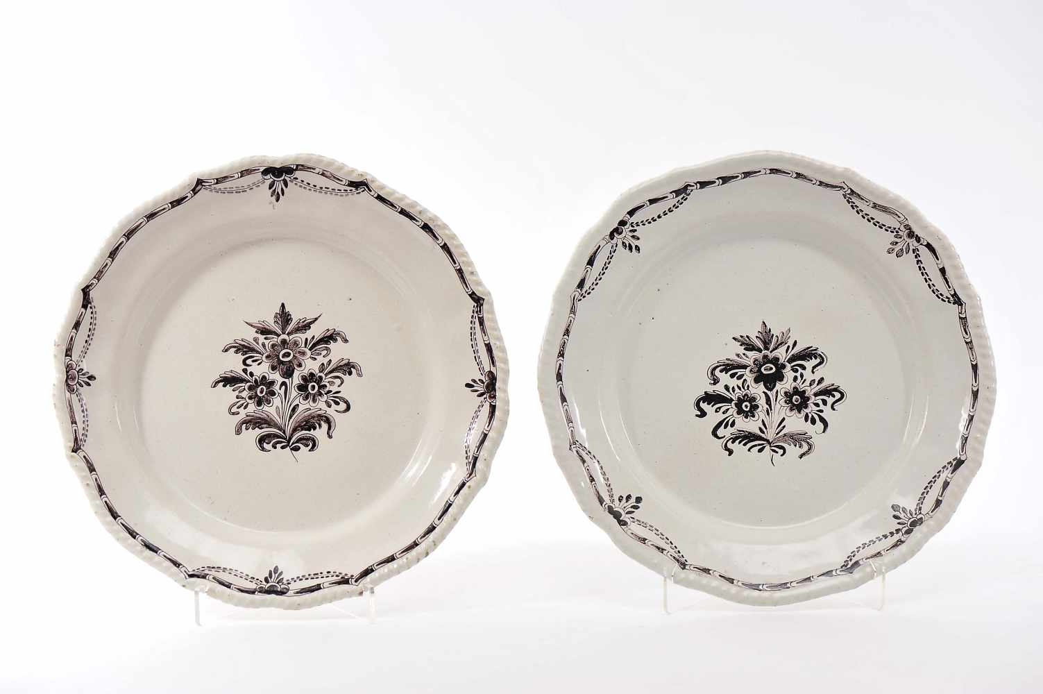 A Pair of Large Scalloped Dishes