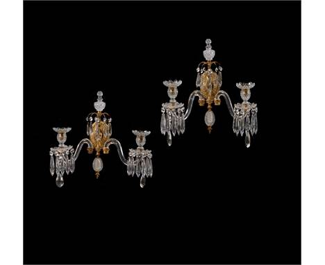 A pair of cut glass and gilt metal mounted twin branch wall appliques in the manner of Osler, late 19th or early 20th century