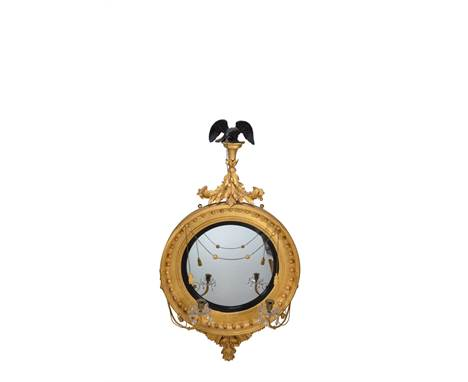 A Regency giltwood convex wall mirror, by Thomas Fentham, circa 1815, bearing an applied fragmentary label for the maker ' TH