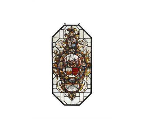 A Netherlandish stained and leaded glass armorial panel, 17th century, of elongated octagonal form, the central oval reserve