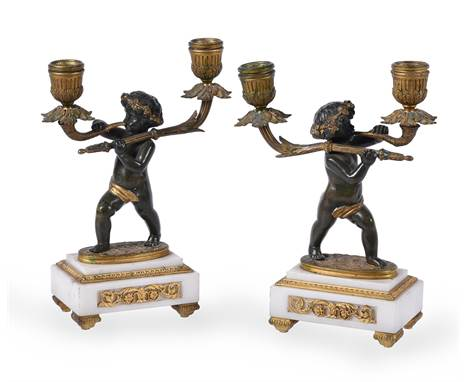 Manner of Claude Galle (French, 1759-1815), a pair of gilt and patinated bronze and marble mounted twin light figural candela