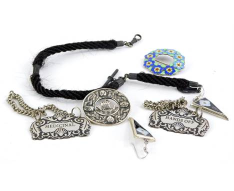 A small group of costume jewellery and effects, to include a watch chain, a silver and enamel floral brooch, a pair of Mexica