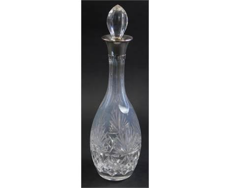An Elizabeth II cut glass decanter, with silver collar, Birmingham 1979, 36cm high.