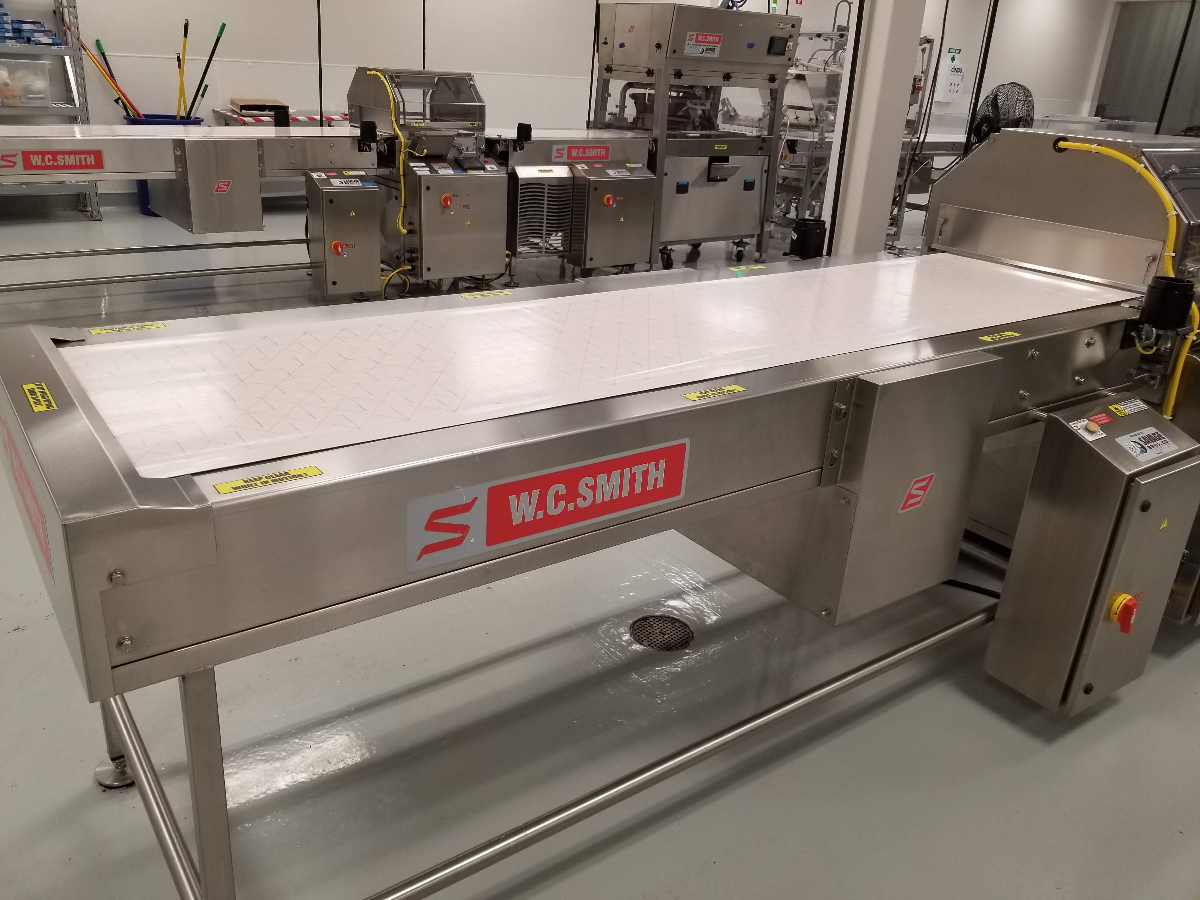 """Lot 17 - Smith 24"""" Stainless Steel Enrobing line – New 2017 - Smith model 5224-49 8-ft long Stainless Steel"""