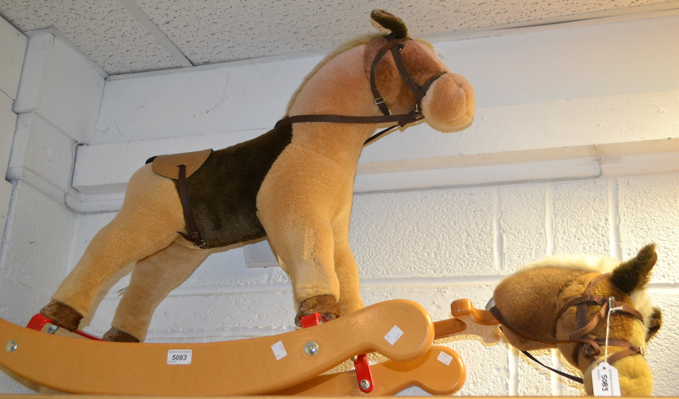 Lot 5083 - A Merrythought rocking horse on wooden rockers,