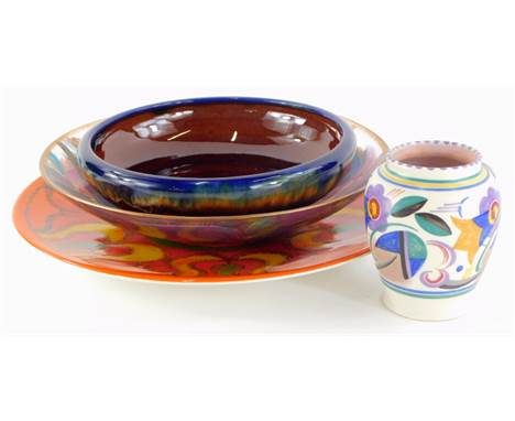 A Poole Pottery Delphis charger, decorated in shades of orange, green, yellow and red, stamped R to reverse, 35cm diameter,