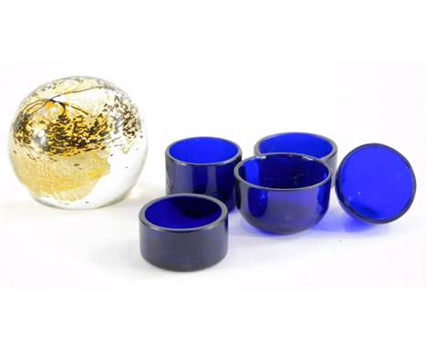 An art glass paperweight, signed Sam Herman Studio 1981, and a collection of five Bristol Blue glass liners.