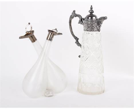 Sterling silver topped oil and vinegar carafe plus a white metal topped glass water jug