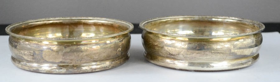 Lot 35 - A pair of silver wine coasters.