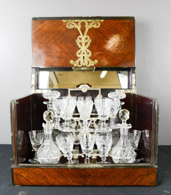 Lot 37 - A 19th century boxed decanter set, comprising two cut glass decanters, glasses, an interior
