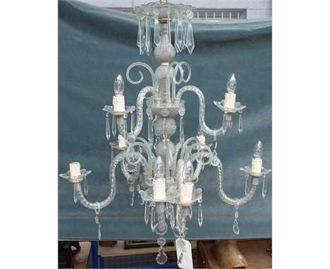 A 20th century Italian style glass nine light chandelier with spiral twist branches over two tiers and hung with cut glass dr