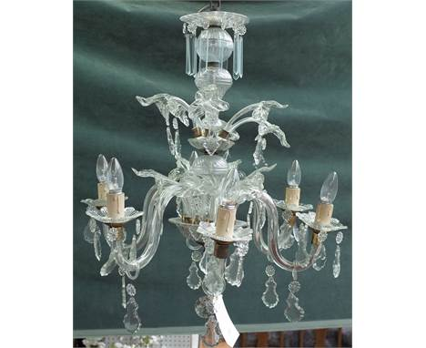 A 20th century Italian style glass six light chandelier with spiral column and moulded branches over two tiers, hung with cut