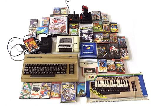 Commodore 64 games console, together with accessories