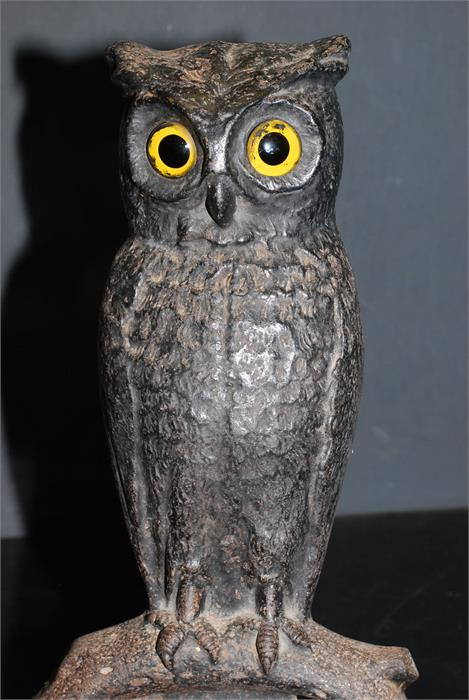 Lot 52 - pair of cast metal perched owl fire dogs / andirons with glass eyes.