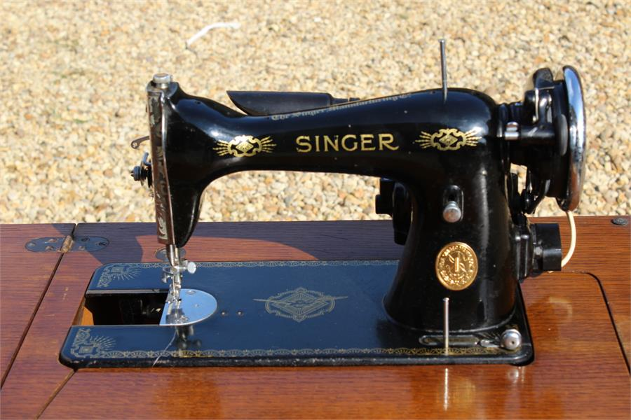Lot 49 - Singer sewing machine in cabinet. (lead cut)