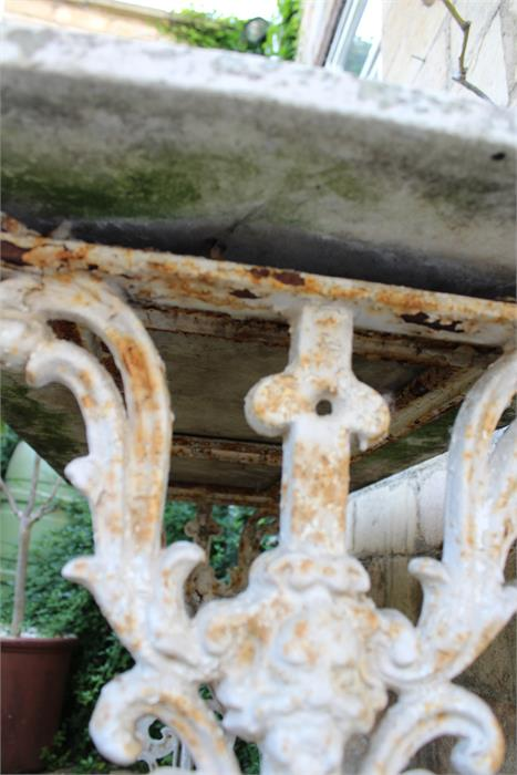 Lot 10 - A painted cast iron / metal garden table with weathered top, appears to be marble. The dimensions