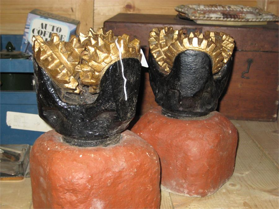 Lot 40 - A pair of industrial well drilling heads mounted as gate finials. NOTE - one loose from base. The