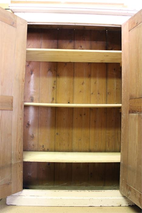 Lot 59 - An impressive very large painted pine estate cupboard in old paint - rounded corners. 212cm x 134 cm