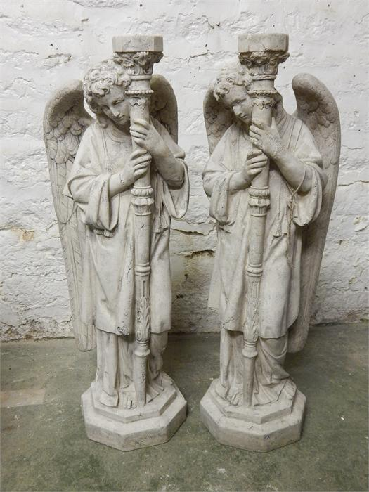 Lot 12 - Two candle pricket stands in the form of winged angels in modern stone-effect resin.