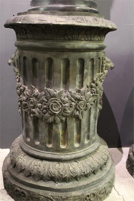 Lot 54 - A pair of 19th / 20th century bronze circular column plinths with lion and floral swag decoration,