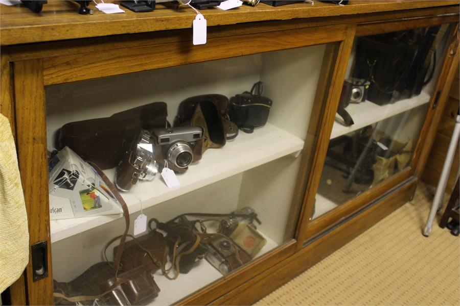Lot 62 - Oak Shop fitting 1st quarter 20th century with glass shelves and glass sliding doors (Comes in two