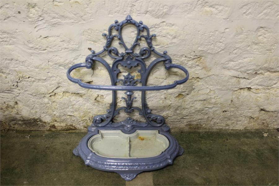 Lot 44 - A decorative blue and cream enameled french style cast metal stick stand, with removable tray