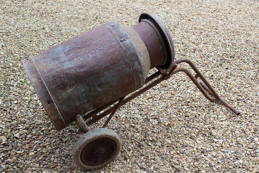 Lot 29 - vintage metal milk churn with lid on a metal trolley