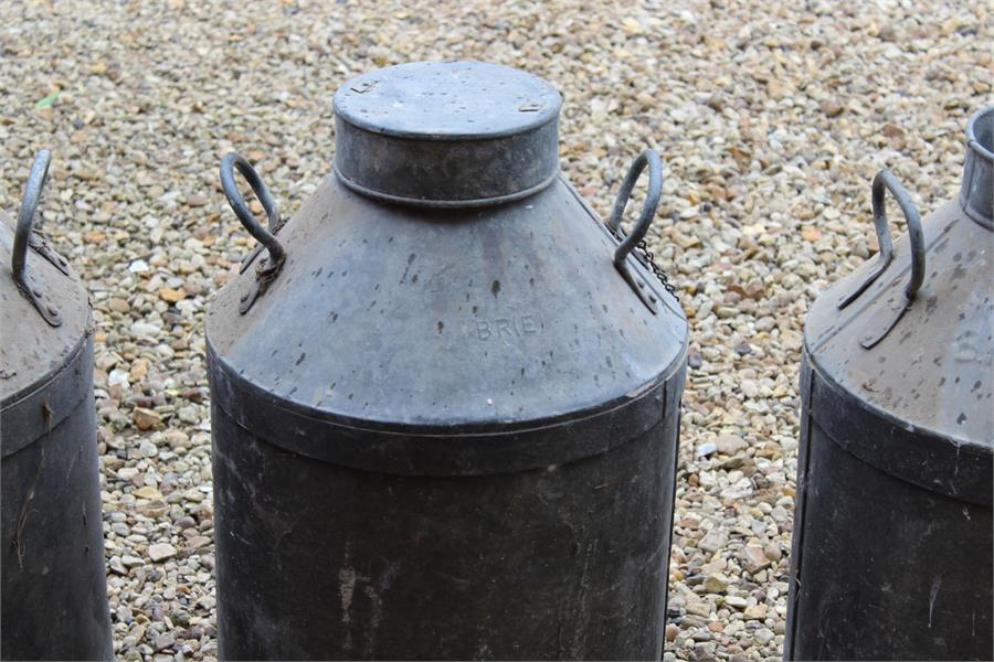 Lot 32 - Railwayana - three vintage BR(e) milk churns ideal for the garden