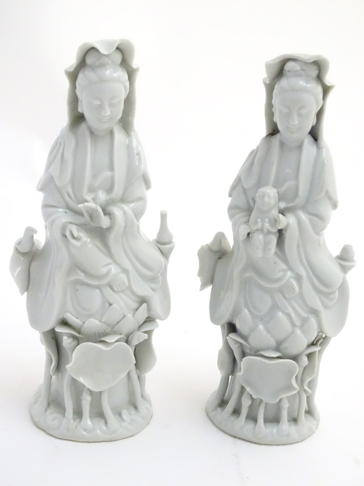 A matched pair of dehua porcelain/blanc de Chine figures,