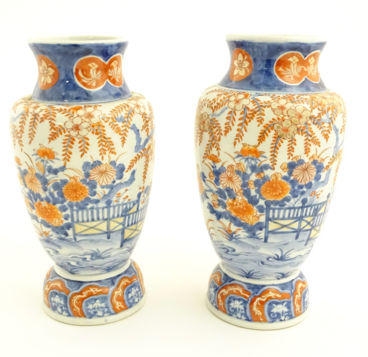 """Lot 24 - Two Imari vases depicting a garden landscape. Approx. 12"""" high."""