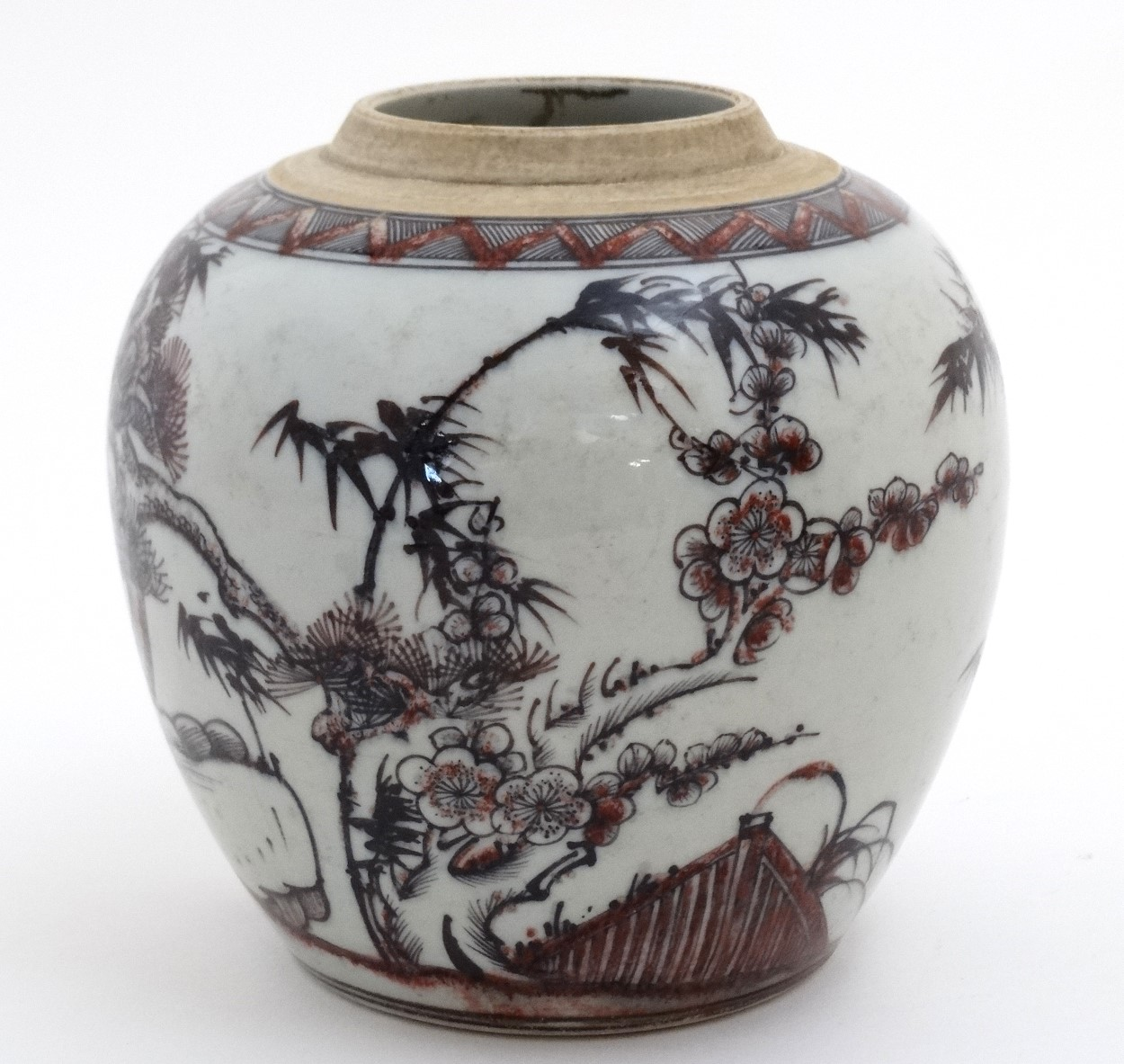 Lot 41 - A Chinese red, black and white vase decorated with cherry blossom and bamboo on a rocky outcrop,